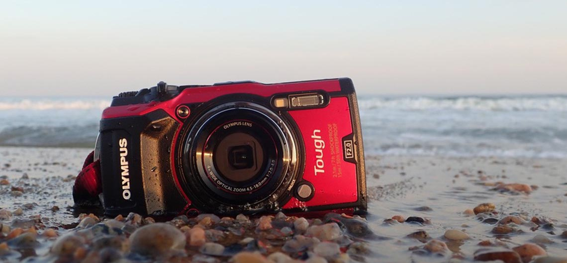 Olympus TG5 sitting on beach