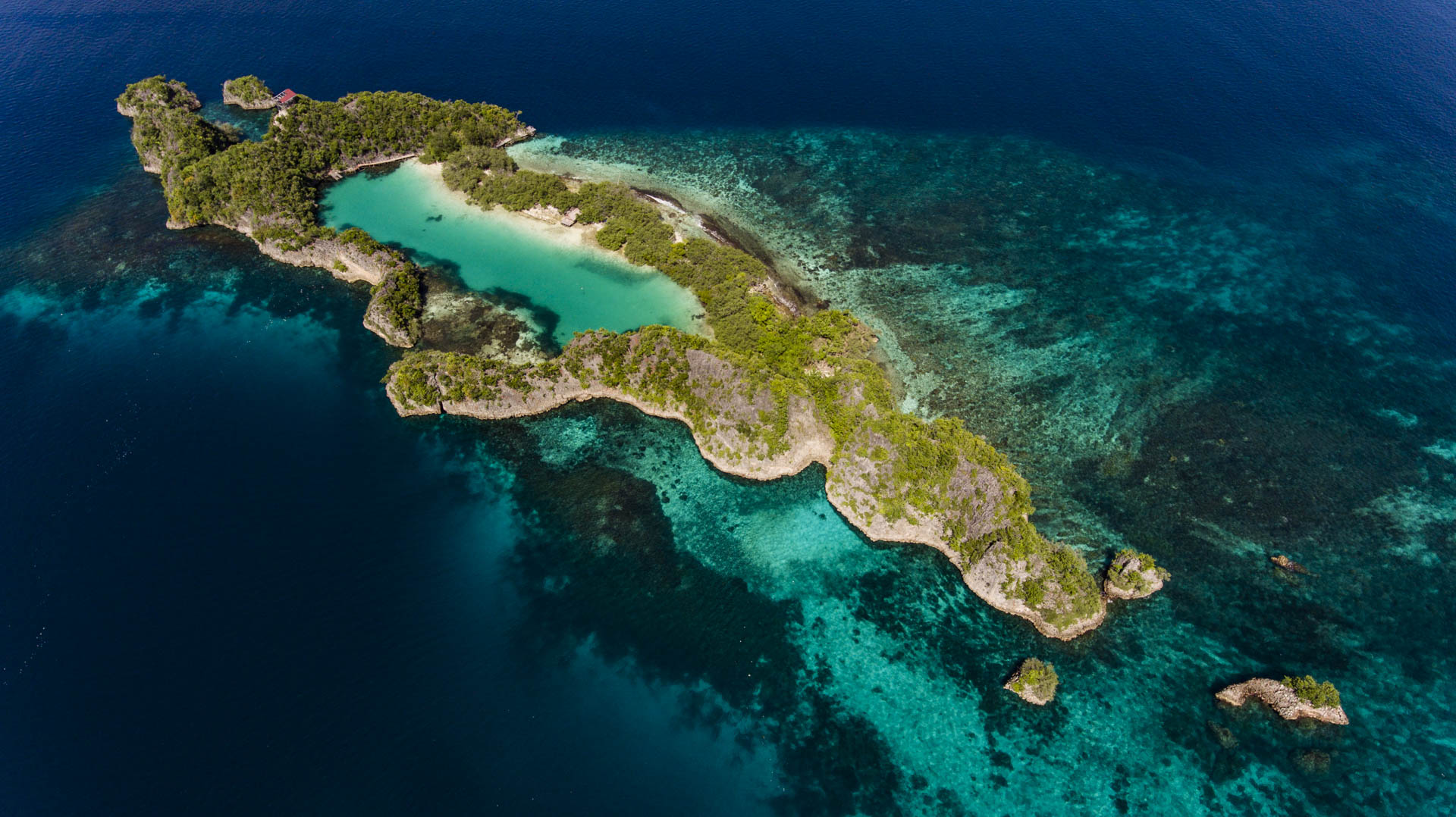 aerial view of tropical island and coral lagoon