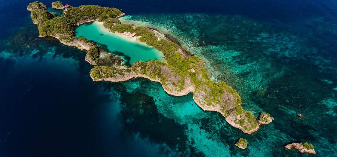 Aerial view of snorkeling site with coral reef and island lagoon