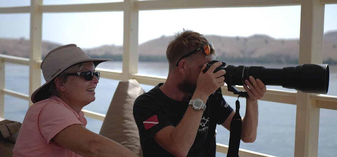 Snorkel Venture guests taking photos from boat