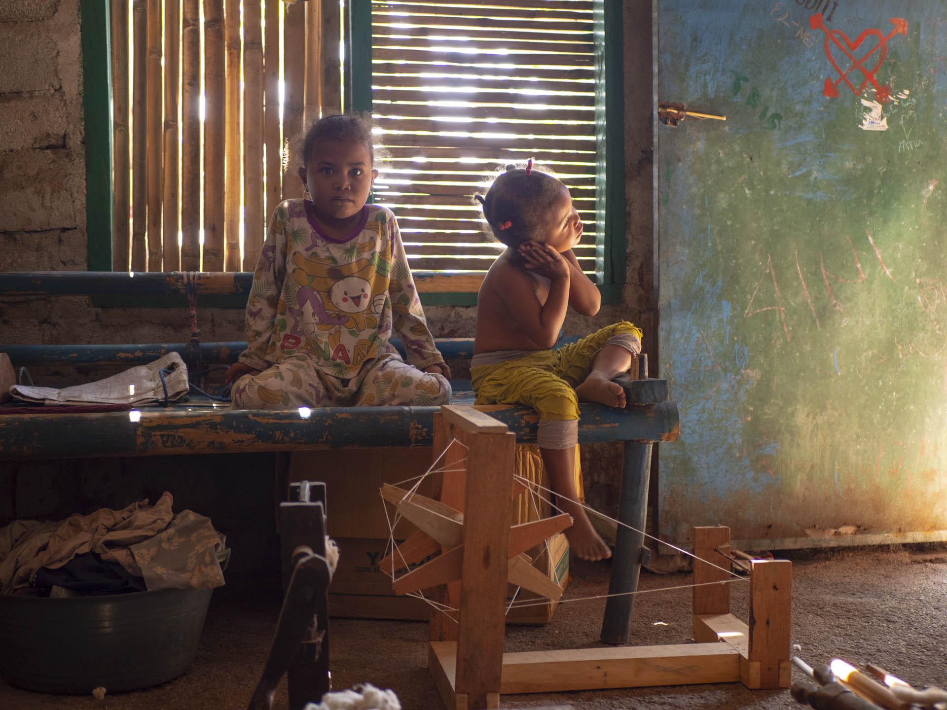 Indonesian children sitting in house