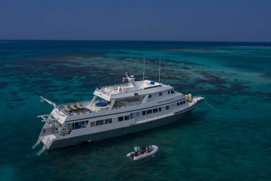 Belize Aggressor III next to coral reef