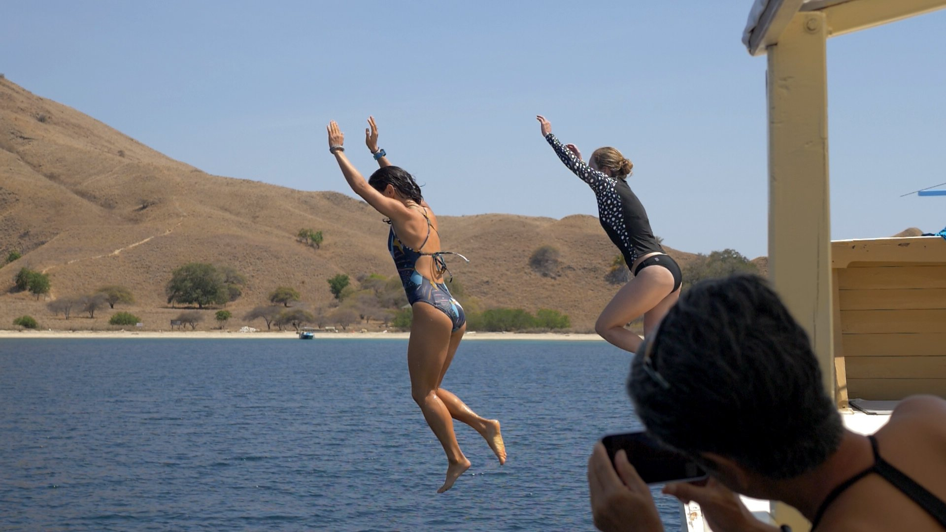 Snorkel Venture guests jumping off boat