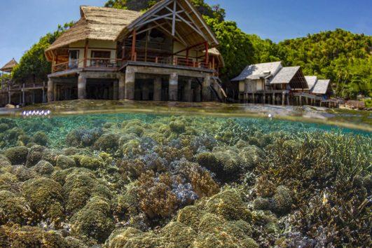 Misool resort bungalow with coral reef below