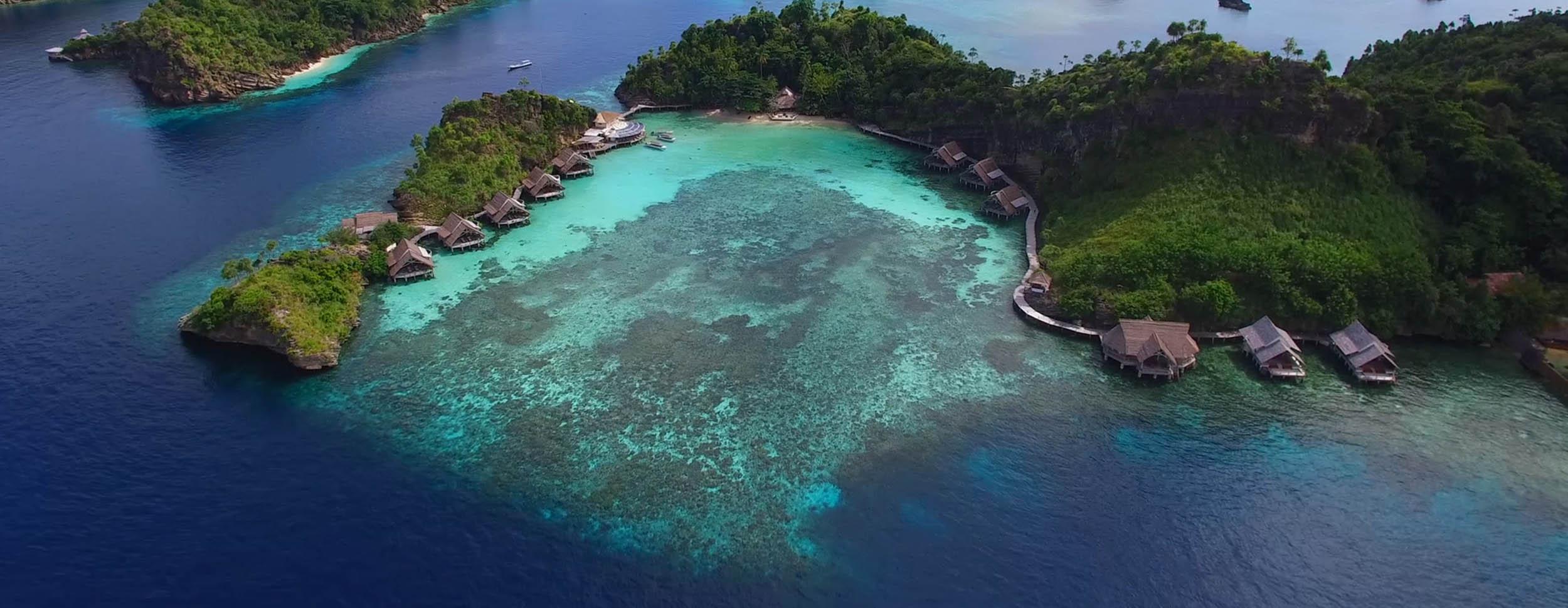 aerial view of misool eco resort's lagoon