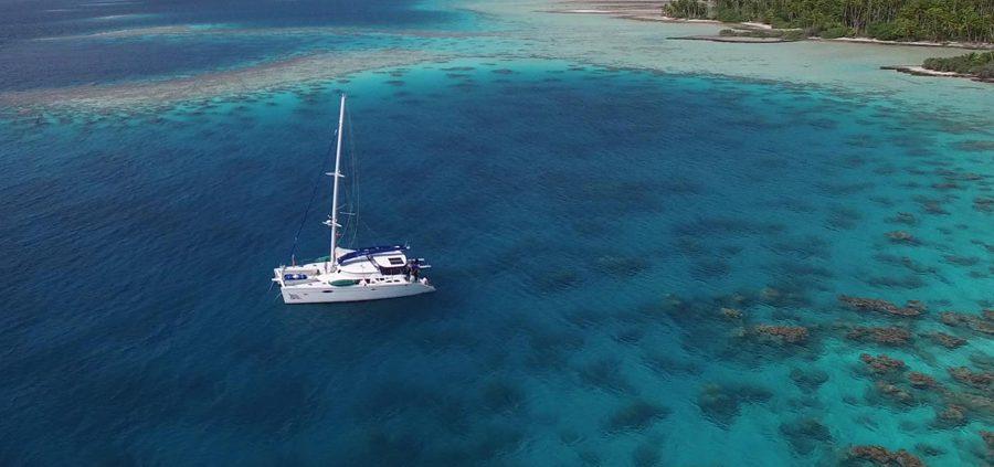 Aqua Tiki II floating above reer