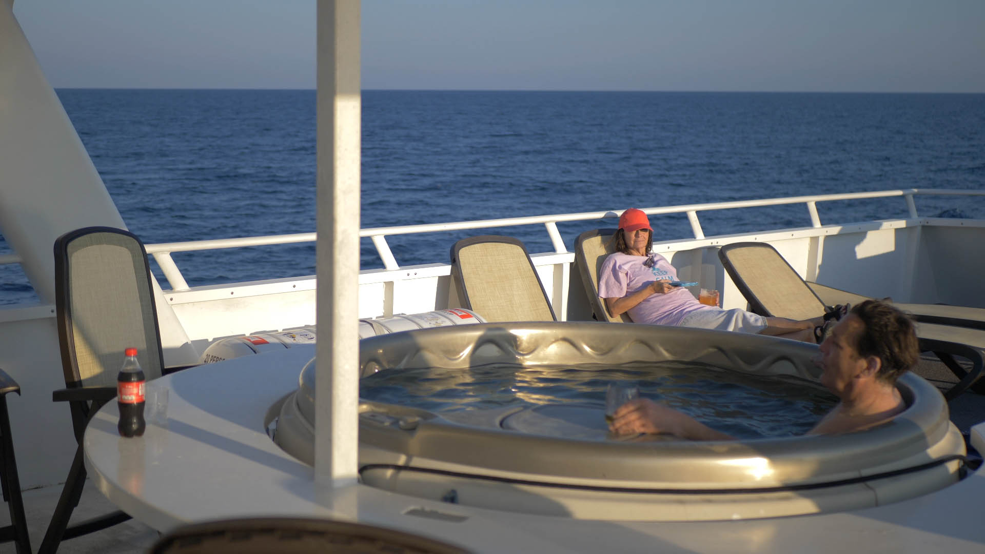 Guests aboard the Belize Aggressor III enjoying the jacuzzi and sun loungers