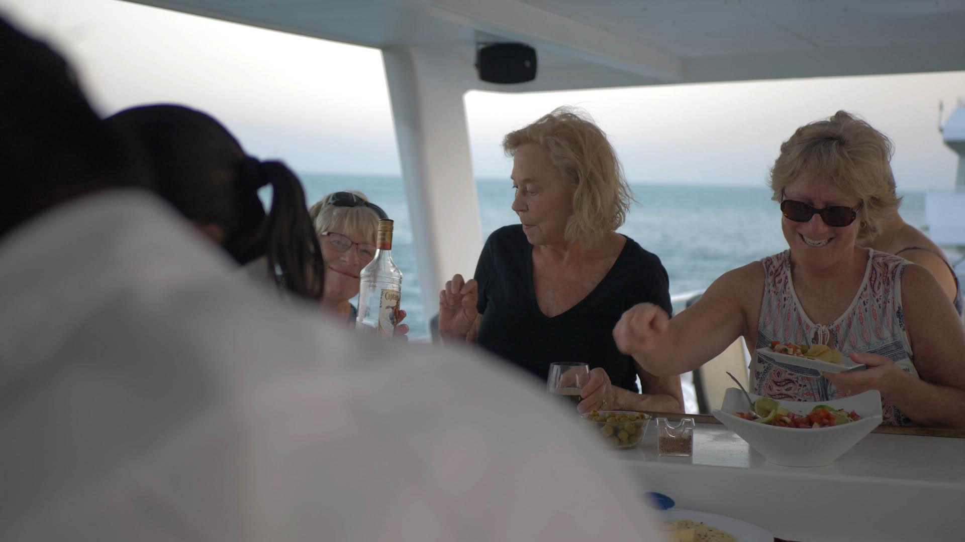 Guests aboard Belize Aggressor III enjoying happy hour