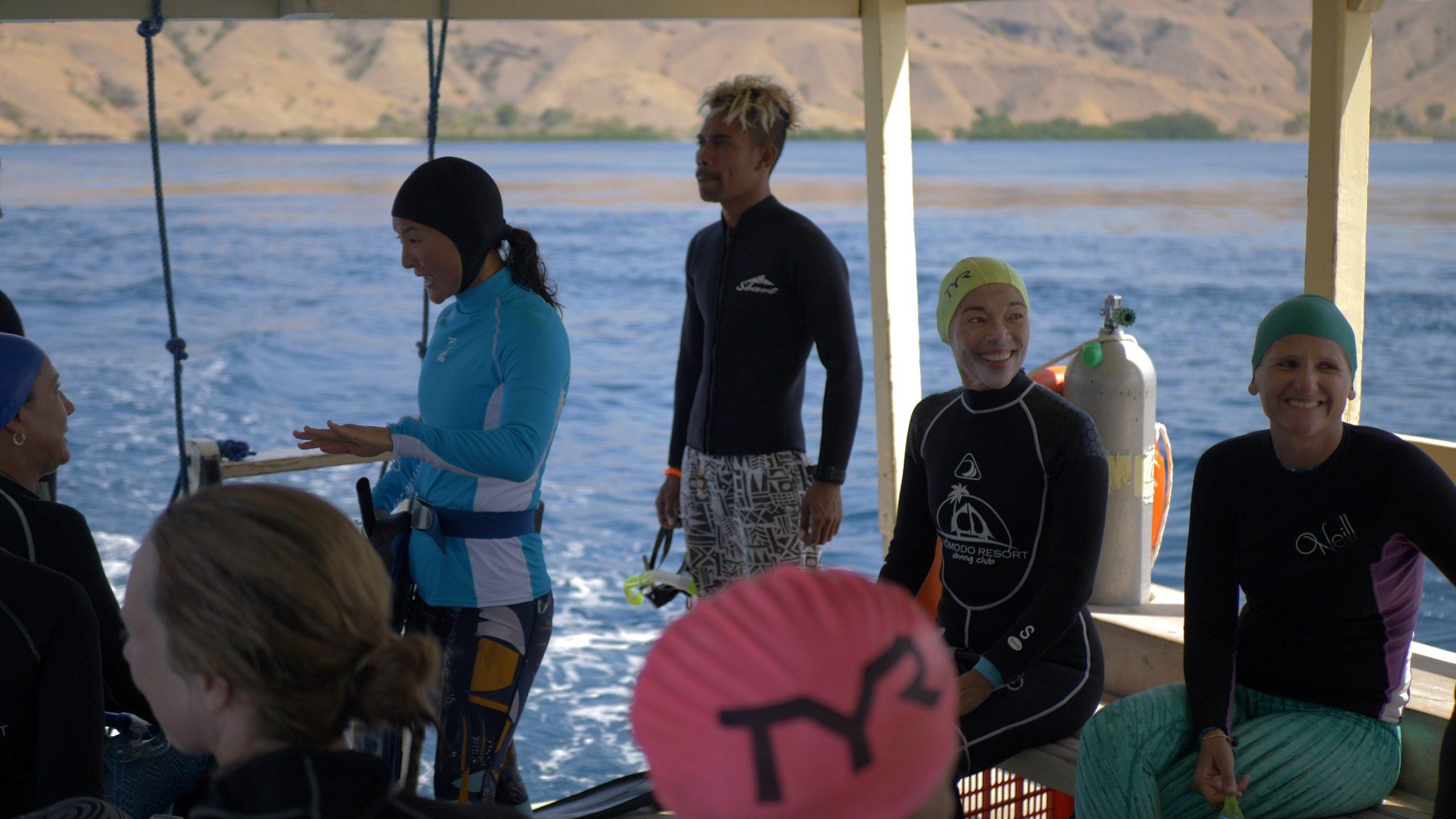 Snorkel Venture guests joking onboard bat in Komodo