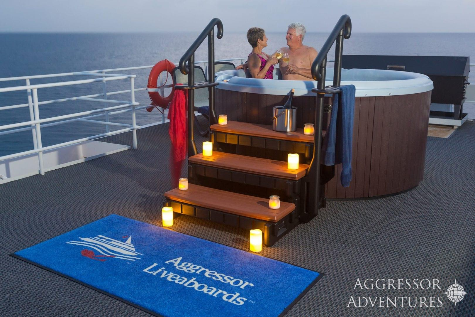 Couple sitting in hot tub on Cayman Aggressor V