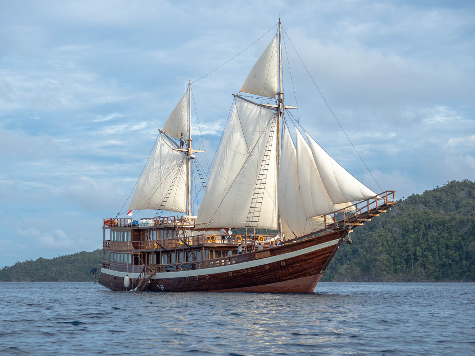 Coralia Liveaboard in front of islands