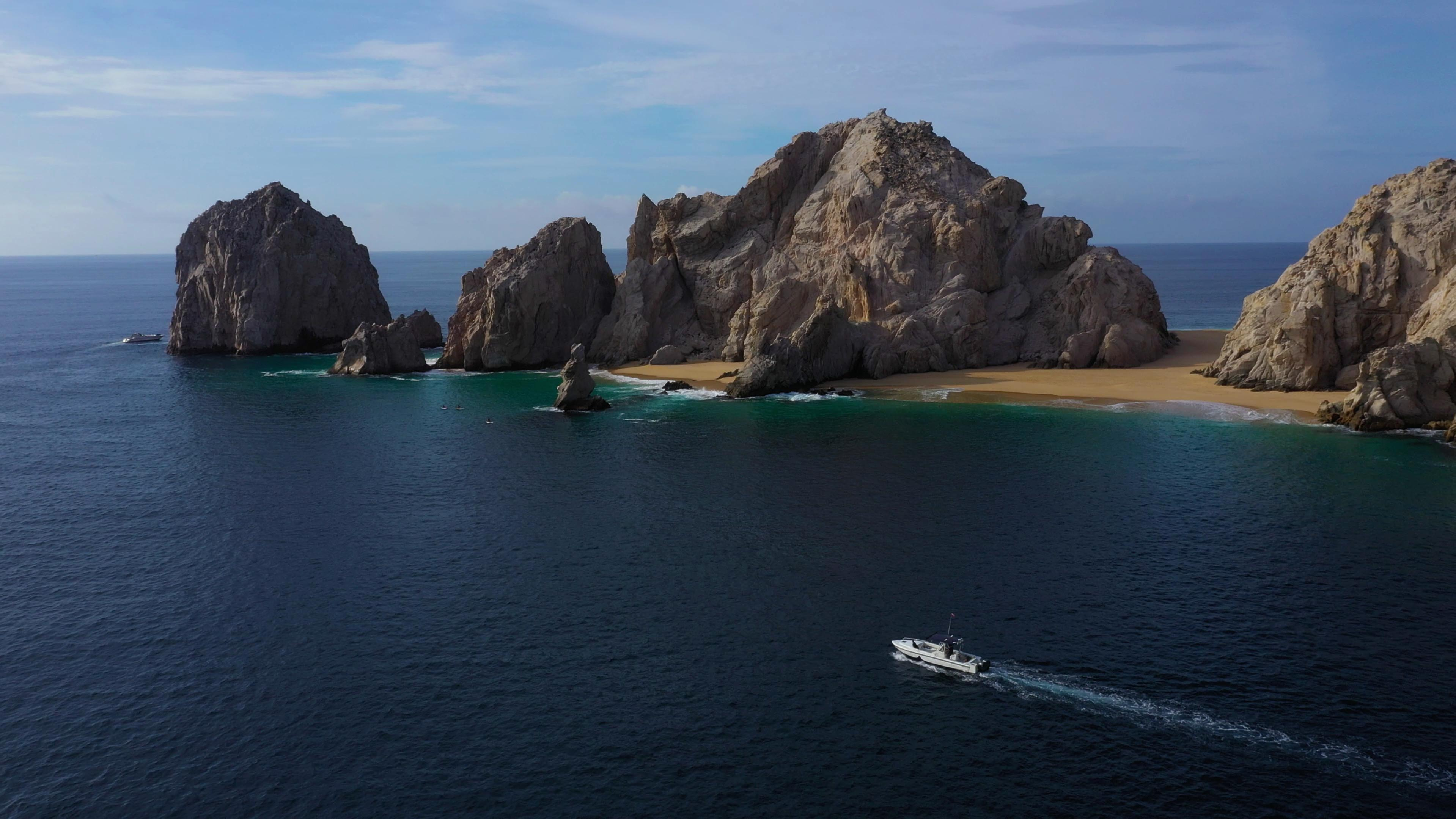 pelagic safari boat in front of Cabo san Lucas clifs