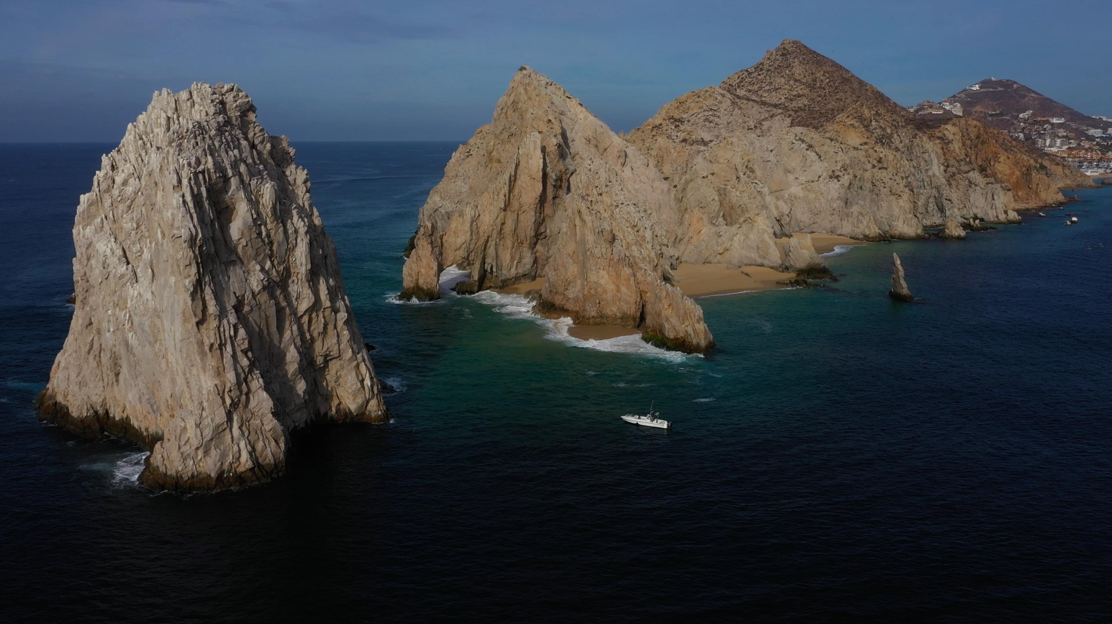 pelagic safari boat in front of Cabo san Lucas clifs