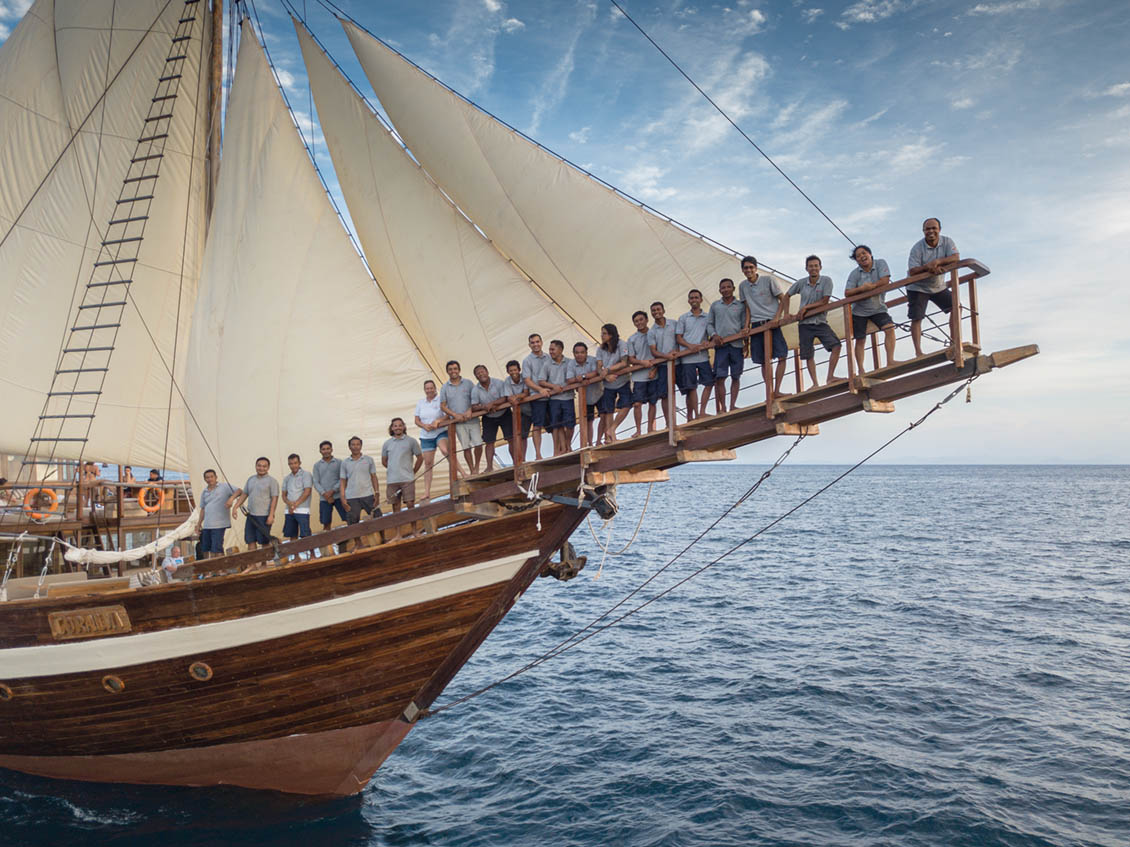 coralia liveaboard with sails up and crew