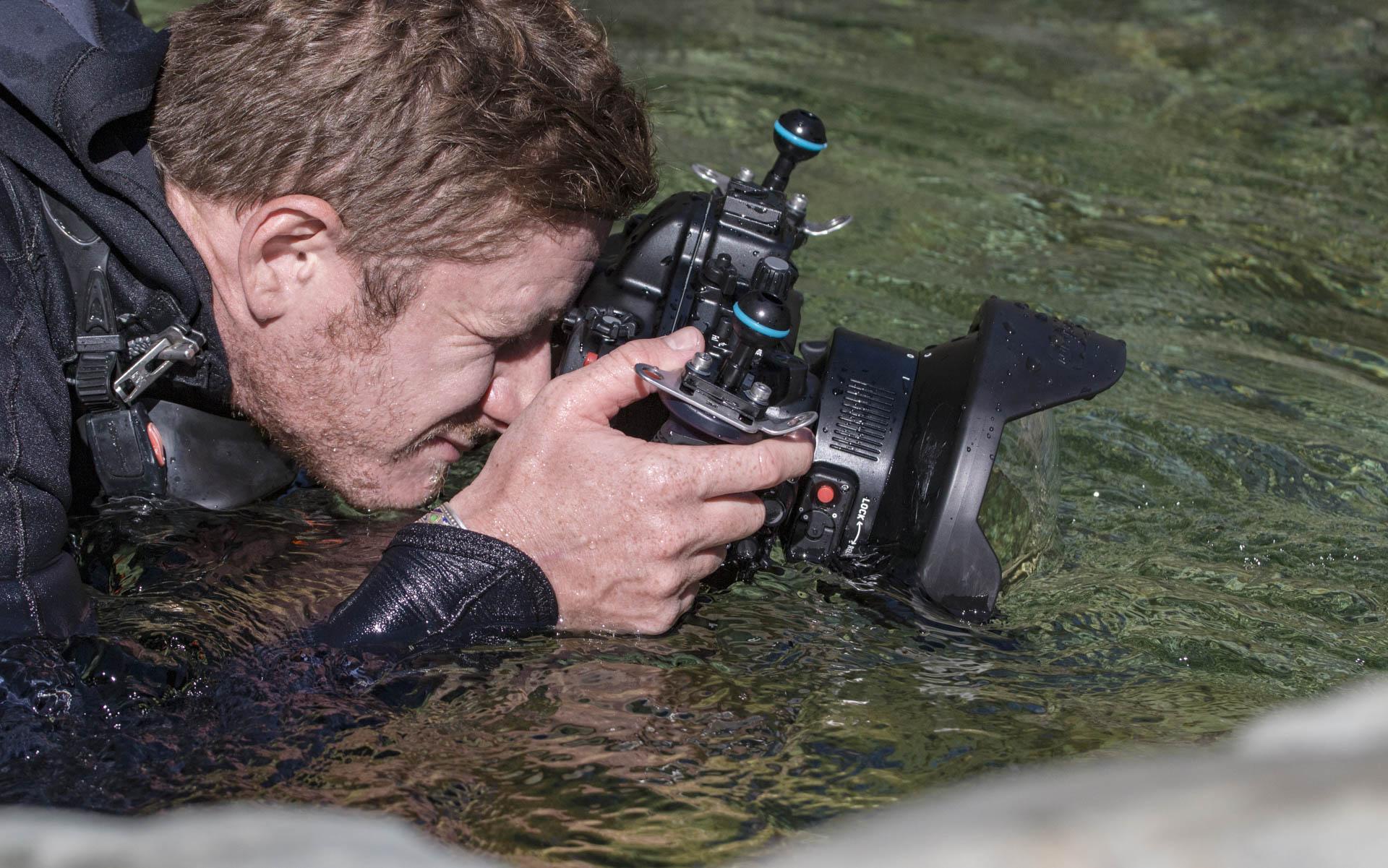 Photographer photographing river scene
