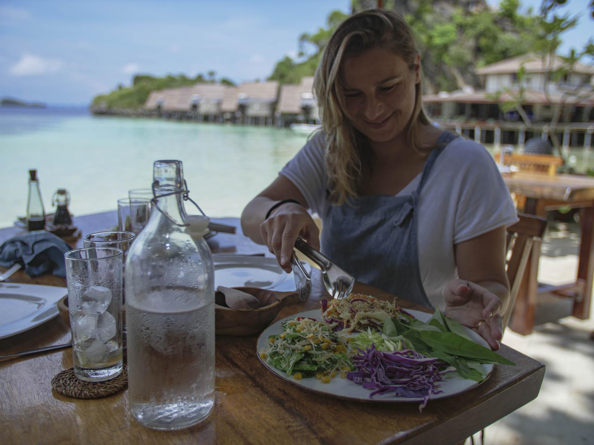 Snorkeling guest admiring the fantastic food at misool resort.