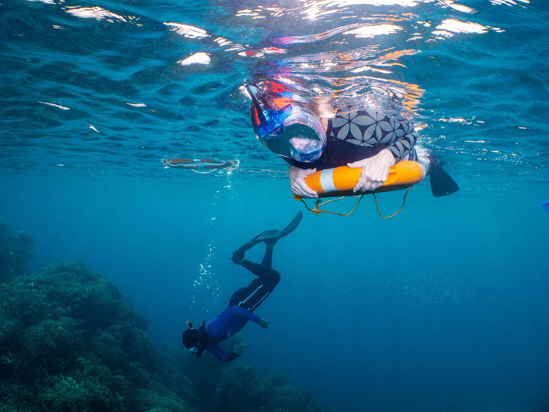 Snorkeler with life ring