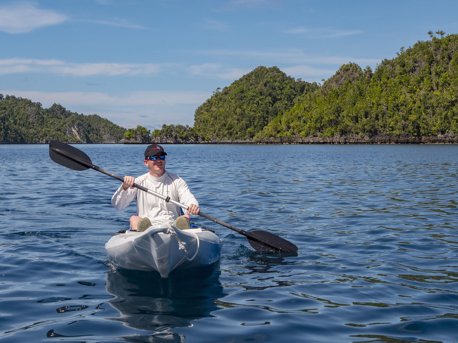 guest kayaking in Raja Ampat